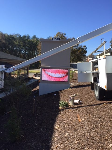 Orthodontist P-10 Full-Color LED Panels on Stucco Sign Monument.