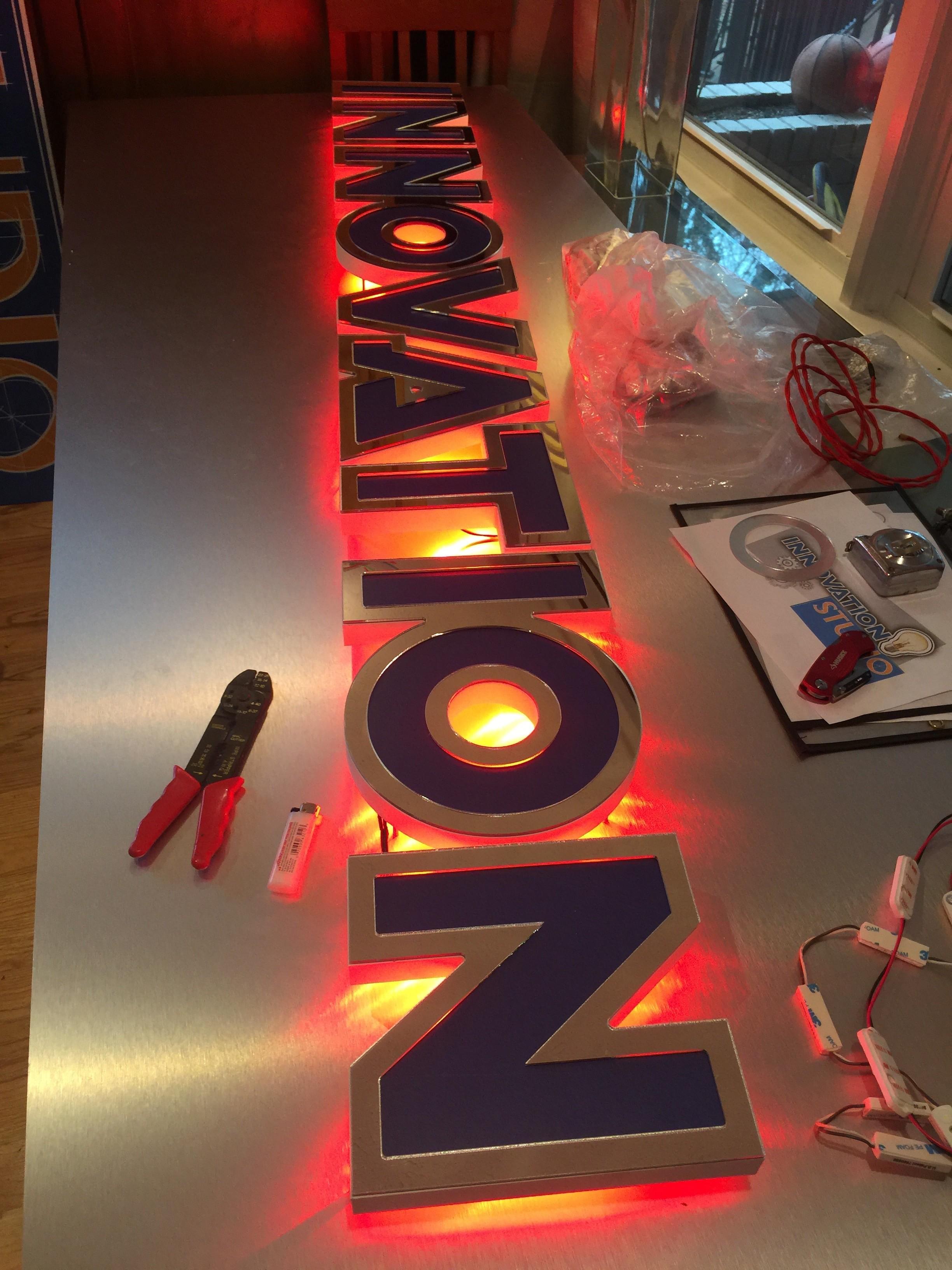 innovation studio red LED back lit letters