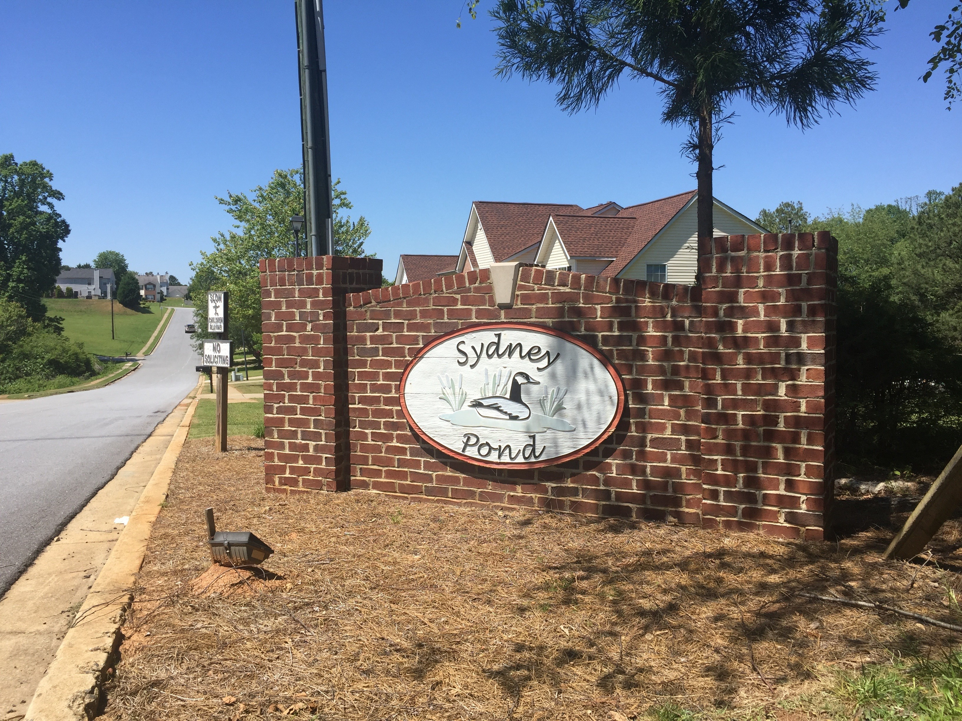 Outdated Neighborhood Entrance Sign Monument