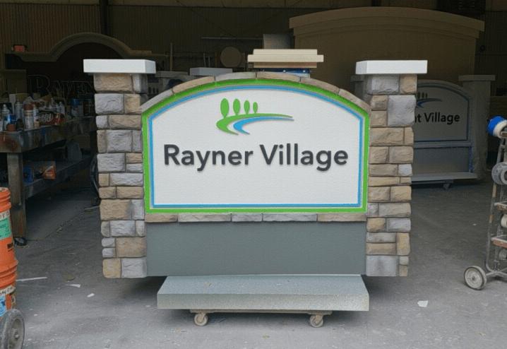 Community Entrance Sign Rayner Village