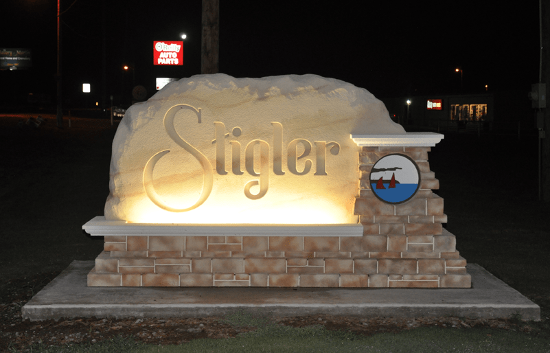 Stigler City Entrance Sign Monument Night Time View Illuminated.