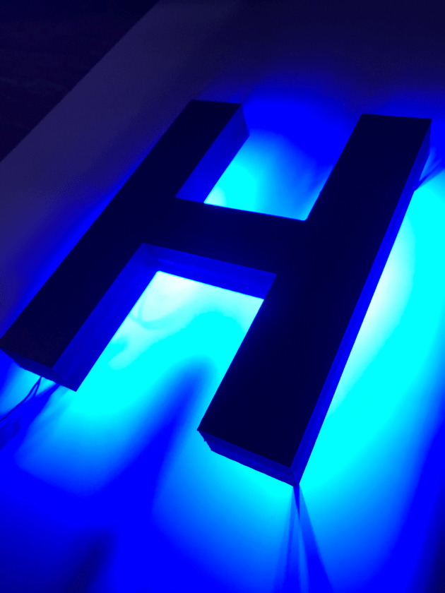 halo-lit LED letters blue glow