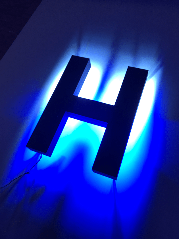halo-lit LED letters fade white to blue glow