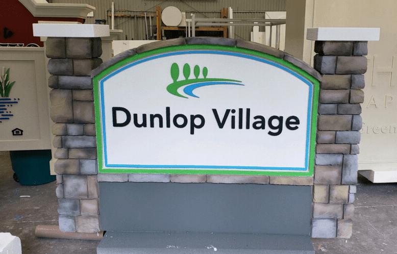 monument sign projects Dunlop Village