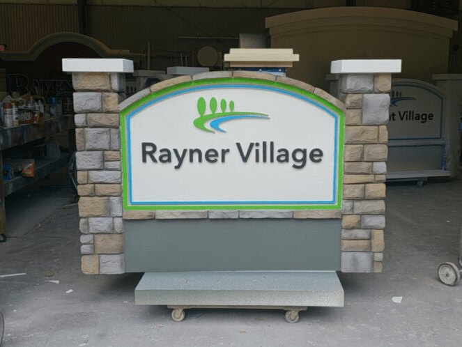 monument sign projects Rayner Village