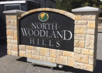 Community Entrance Sign Monument with Faux Grainte Sign Panel and Block Stone