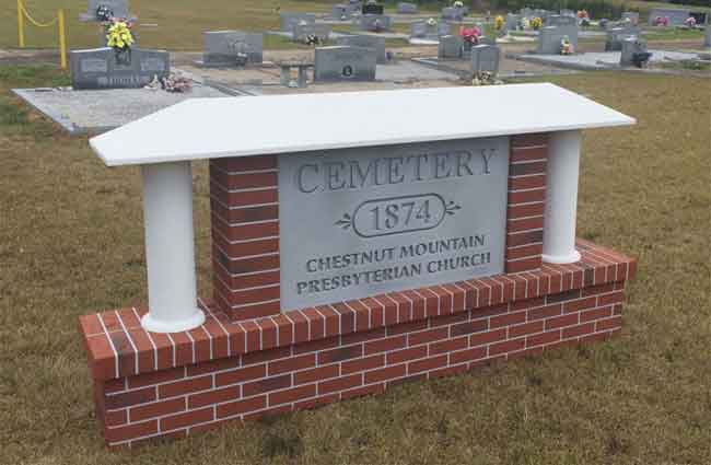 Cemetery Sign Monument with Faux Brick, Faux Granite Tombstone, Stucco Columns and Stucco Roofline Cap