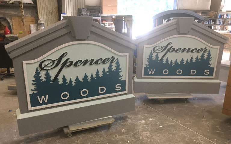 These are the main entrance signs for Spencer Woods, a townhouse community in Maryland.